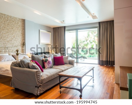 Modern bedroom interior decorated with vintage furniture - stock photo