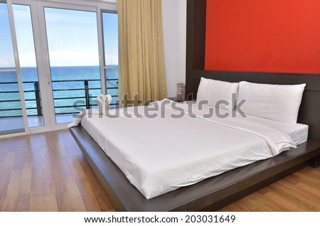 Modern bedroom interior with seascape view   - stock photo