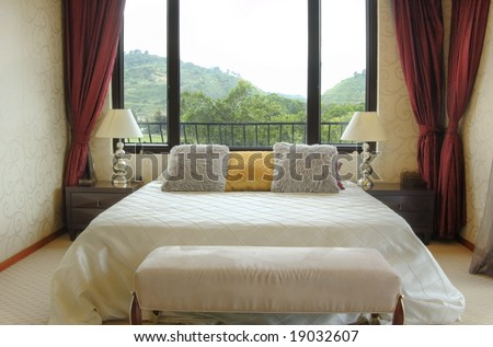 Modern bedroom with big window. - stock photo
