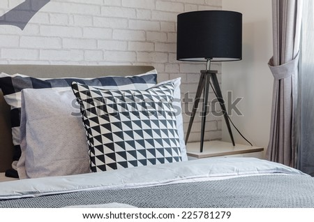 modern bedroom with black and white pillows at home - stock photo