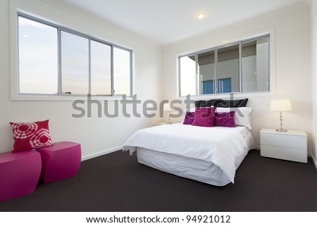 Modern bedroom with double bed - stock photo