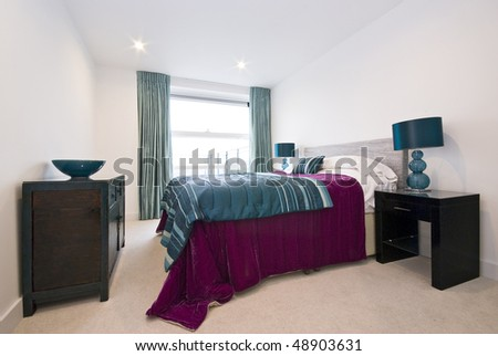 Modern bedroom with king size bed - stock photo