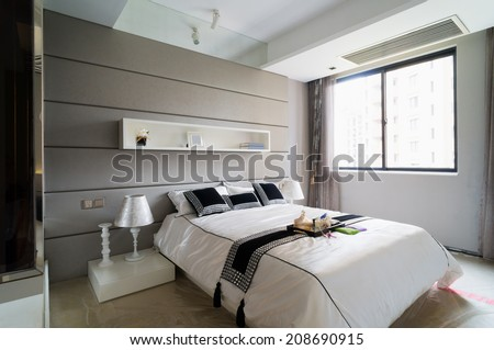 modern bedroom with nice decoration - stock photo