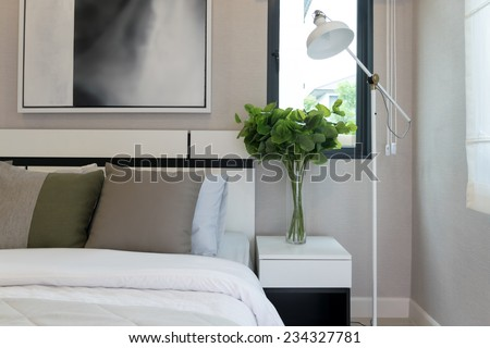 modern bedroom with white lamp at home - stock photo
