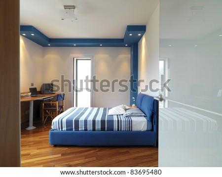 modern bedroom with wood floor - stock photo
