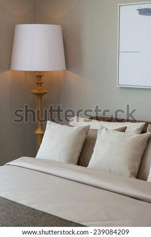 modern bedroom with wooden lamp and pillows