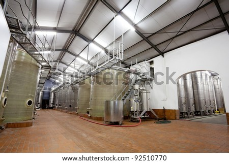 modern beverage factory with large tanks - stock photo