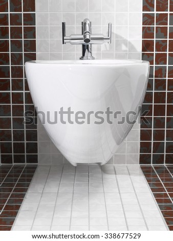 Modern bidet in white and red bathroom