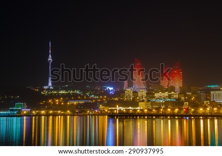 Modern big city skyline at night. Baku Flame Towers and TV Tower - stock photo