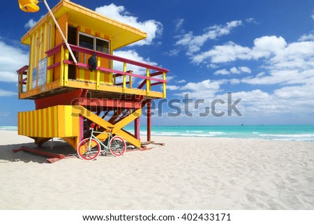 Modern bike & lifeguard station on the huge beach of Miami Beach. No people. - stock photo