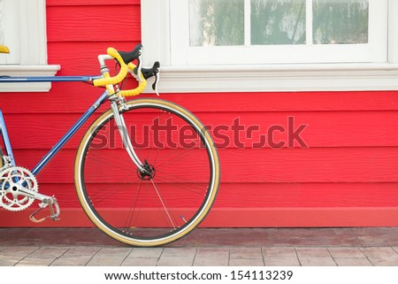 Modern bike stand near wooden wall, Sport or Recreation concept - stock photo