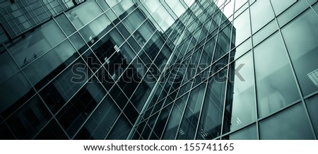 Modern black and blue glass silhouettes of building skyscrapers. Business concept of successful industrial solid and steel architecture background texture - stock photo