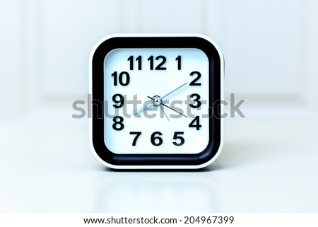 Modern Black and White Alarm Clock on White Background. - stock photo