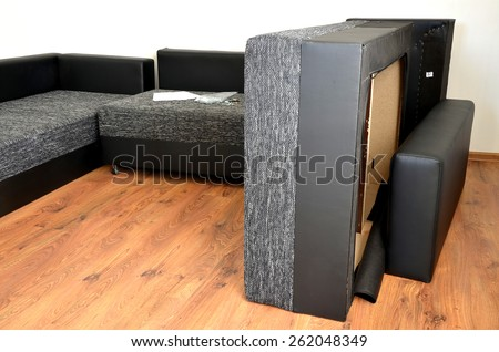 Modern black and white cloth sofa assembly - stock photo