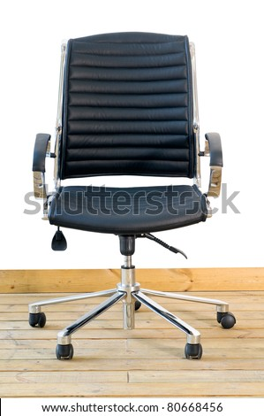 modern black leather office chair on wood floor over white background - stock photo