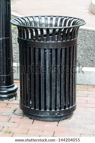 Modern black trash bin - stock photo