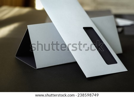 Modern blank envelope and letterhead. Shallow depth of field. - stock photo