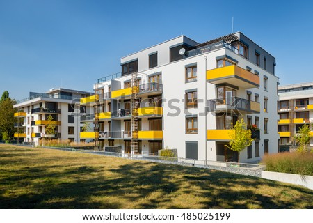 Modern block of flats with yellow balconies