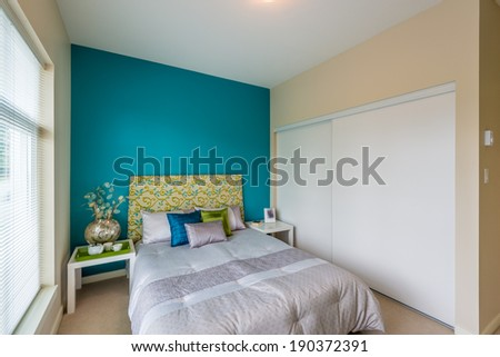 Modern blue bedroom interior in a luxury house - stock photo