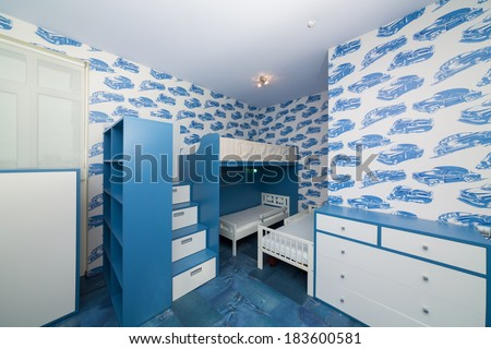 Modern blue childrens bedroom with bunk beds. - stock photo