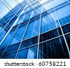 modern blue glass wall of skyscraper - stock photo