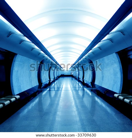 Modern blue hall in metro station - stock photo