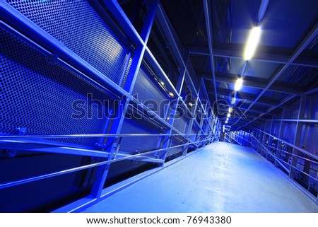Modern blue industrial tunnel at night - stock photo