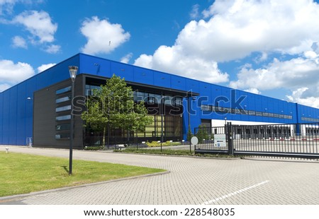 modern blue warehouse in the Rotterdam harbor area