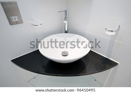 modern bowl style hand wash basin on a granite corner shelf. Modern Designer Hand Wash Basin Bowl Stock Photo 48997192