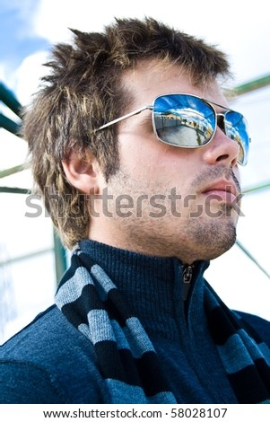 modern boy with glasses and a striped scarf - stock photo