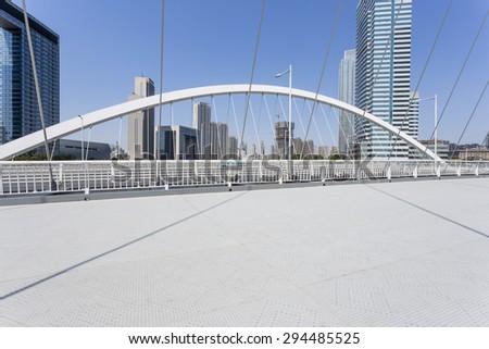modern bridge and empty road floor - stock photo