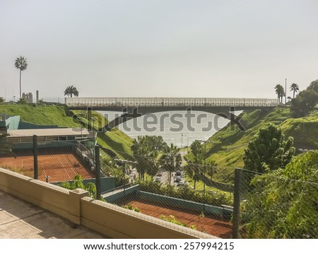 Modern bridge in front of pacific ocean in the coast of the city of Lima in Peru, South America.