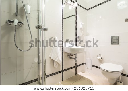 Modern, bright bathroom in black and white - stock photo