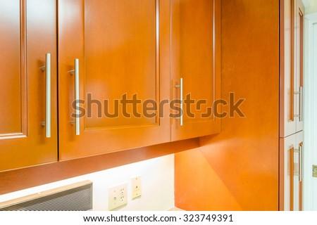 Modern, bright, clean, empty kitchen interior in a luxury house - stock photo