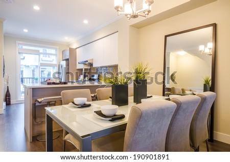 Modern bright dining room with kitchen in a luxury apartment. Interior design. - stock photo