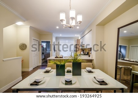 Modern bright dining room with kitchen in a luxury apartment. Interior design.