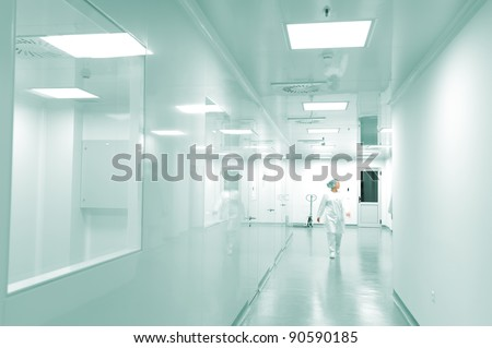 Modern bright factory interior with working people in motion - stock photo