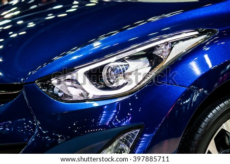 Modern bright front light of car - stock photo