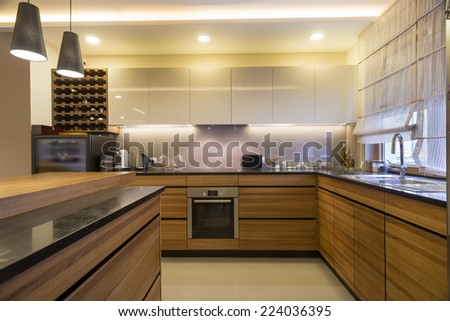 Modern bright kitchen interior - stock photo