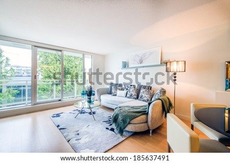 Modern bright living room in a luxury house. Interior design. - stock photo