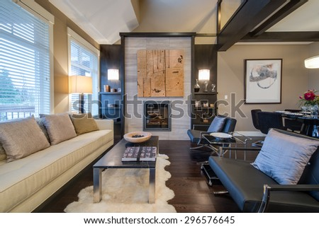 Modern bright living room  with fireplace and sitting area. Interior design. - stock photo