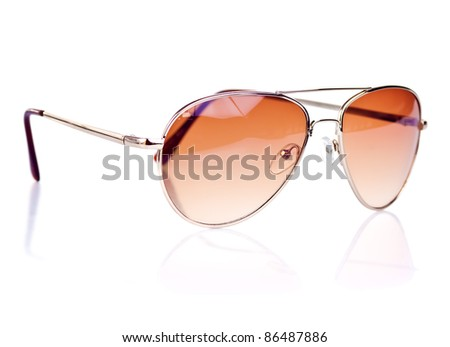 Modern brown tinted sunglasses on a white background with reflections