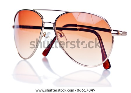 Modern brown tinted sunglasses on a white background with reflections - stock photo