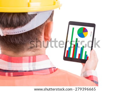 Modern builder or construction worker checking financial charts and statistics on wireless tablet - stock photo