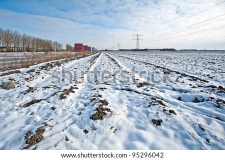 Modern building along a snowy field in winter - stock photo