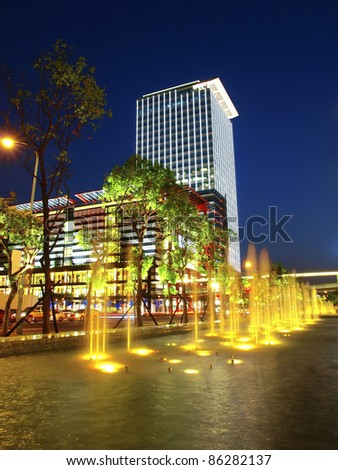Modern building and  fountain in night - stock photo