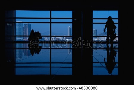 modern building and people silhouettes - stock photo