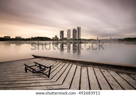 Modern Building Architecture and Sunset with Full Reflection at Putrajaya Lake. Vibrant Colors, Soft Focus. Copy Space Area