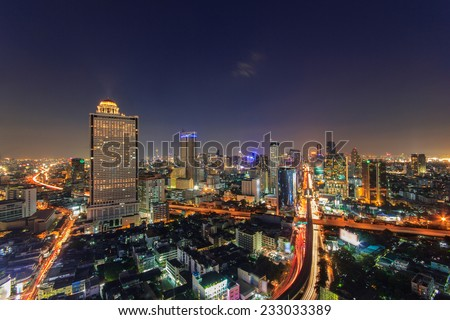 Modern building at riverside in twilight scene at Bangkok, Thailand - stock photo