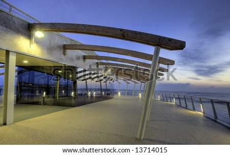 Modern building at the end of a brand new pier photograhed at dusk in tuscany, Italy
